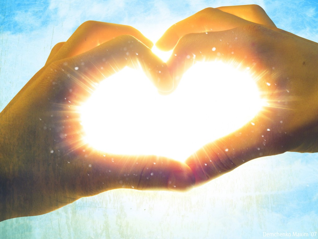 hands_making_love_heart_with_shining_light